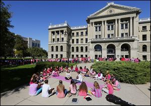 CTY pink28p Senior Aria Machinski and eighth grader  Ross Thompson sing a song as Toledo School for the Arts surround the Lucas County Courthouse dressed in pink for