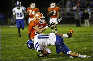 Anthony Wayne defensive back Josh Schwerer (11) forces Southview's Sterling Tyler to give up the ball as he tackles him during the Anthony Wayne-Southview game Friday night in Sylvania. The visiting Generals lost 28-7.