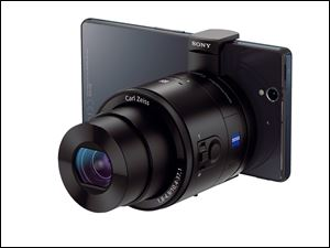 Sony's QX100 camera, which connects wirelessly to a cell phone, offers manual controls, optical image stabilization, a tripod mount, and a Zeiss f/1.8 lens.