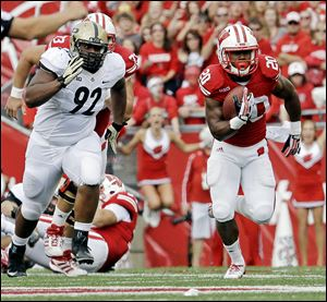 Wisconsin's James White breaks away from Purdue's Ryan Watson for a 70-yard touchdown run last weekend. White is the active career rushing leader in the FBS.