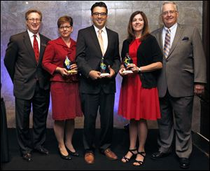 From left, presenter Keith Burwell, of the Toledo Community Foundation; awardees Jan Ruma, of Toledo/Lucas County CareNet, Marc Folk, of Arts Commission of Greater Toledo, and Kim Partin, of the East Toledo Family Center, and presenter Joe Zerbey, of the Blade, during the 2013 Innovation and Excellence Awards ceremony.