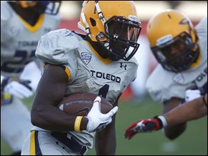 Toledo's Bernard Reedy runs for yardage against Ball State University.