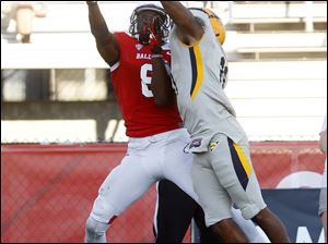 Toledo's Chearham Norrils (right) breaks up a pass intended for Ball State University's Jordan Williams.
