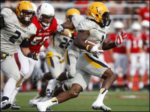 Toledo's Bernard Reedy (right) runs down the field.