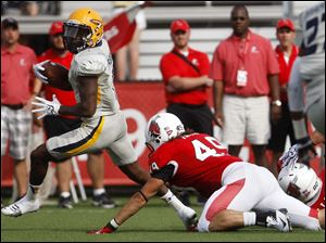 Toledo's Bernard Reedy (left) avoids a tackle attempt by Ball State's Joseph Fazio.