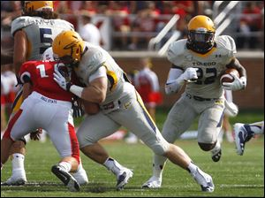 Toledo's David Fluellen (right) runs the ball up field.