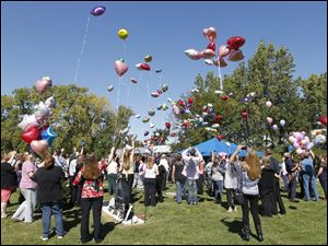 Balloons are released into the air at the Lake Township Cemetery in Millbury, Ohio in memory of Elaina Steinfurth.