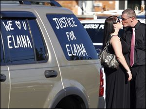 Becky Navaugh and her boyfriend Terry Steinfurth Jr. share a moment before the start of Elaina Steinfurth's funeral.