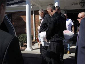 Terry Steinfurth Sr., grandfather of Elaina Steinfurth, and her father Terry Steinfurth Jr., right front, carry Elaina's casket.