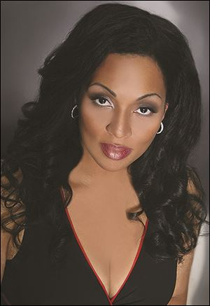 Othalie Graham sings the role of Aida.