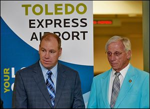 The Toledo-Lucas County Port Authority, led by Paul Toth, left, has rejected invitations to rejoin the Great Lakes Cruising Coalition. Board member Jerry Chabler, right, thinks his agency needs to promote Toledo as a nautical city.
