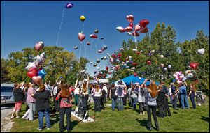 Mourners of Elaina Steinfurth release balloons at the Lake Township Cemetery in Millbury, where the toddler was buried on Saturday. Elaina went missing on June 2.