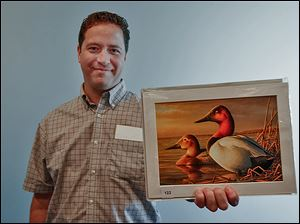 Adam Grimm of South Dakota, a native of Elyria, is the winner for this year's Federal Duck Stamp Art Contest, with his oil painting of a pair of Canvasbacks.
