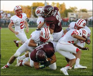 Genoa running back David Nutter (25) scores a touchdown against Eastwood during a football game Friday in Genoa, Ohio.