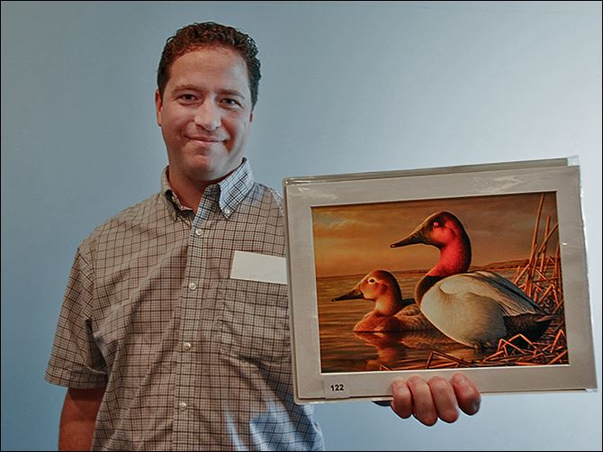 s1grimm-7 Adam Grimm of South Dakota, a native of Elyria, is the winner for this year's Federal Duck Stamp Art Contest, with his oil painting of a pair of Canvasbacks.