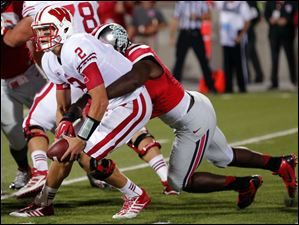 Ohio State's Noah Spence (8) rushes Wisconsin QB Joel Stave (2) during the fourth quarter.