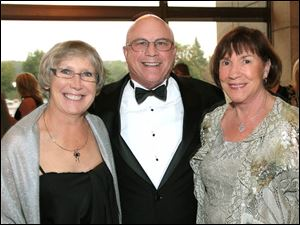 Dr. Barry Knotts, center with his wife Denise, left, and Karen Merrels, right.
