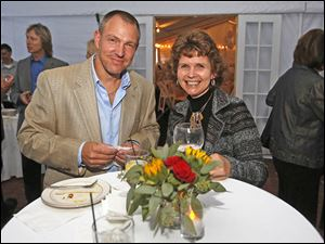 Ryan Bauman, owner of the Karnik Pet Lodge, left, and Denise Bryan, of Tontogany, attended the benefit dinner hosted by Susan and Allan Block at their home in West Toledo.