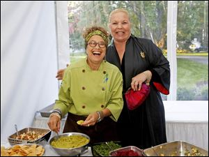 Chef Susan Feniger, left, cooked for guests, including Paula Tuschman, of Sylvania, right, during the benefit dinner hosted by Susan and Allan Block at their home in West Toledo.