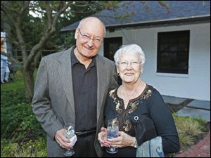Tom Reid, left, and Judy Reid Aubry attended the benefit dinner hosted by Susan and Allan Block at their home in West Toledo.