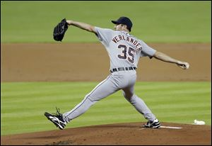 Detroit Tigers' Justin Verlander pitches to the Miami Marlins in the first inning. Tigers lost in ninth inning.