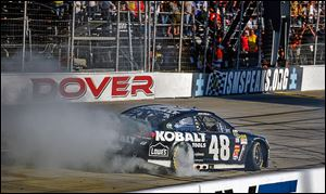 Jimmie Johnson performs a burnout after he won Sunday's race at Dover International Speedway. The victory moved into second place in the Chase.