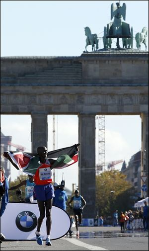 Wilson Kipsang from Kenya celebrates winning the 40th Berlin Marathon today in Berlin, Germany. Kipsang set a new world record of 2 hours, 3 minutes and 23 seconds.