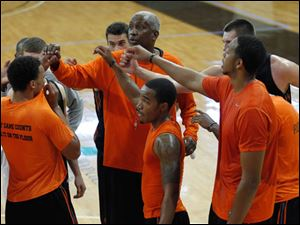 BGSU head coach Louis Orr, center, huddles with the team.