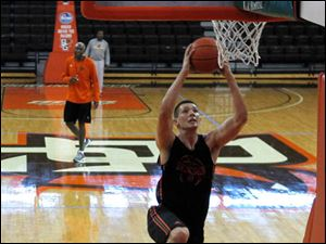 Freshman Garrett Mayleben goes for a layup.