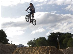 Chris Prebula, 18, of Petersburg, Mich. hits a jump at the Jermain BMX Bike Park in West Toledo.