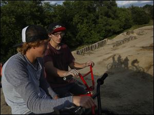 Chris Prebula, 18, left, of Petersburg, Mich. and Jon Carpenter, 18, of Swanton talk before hitting the jumps at Jermain BMX Bike Park in West Toledo.