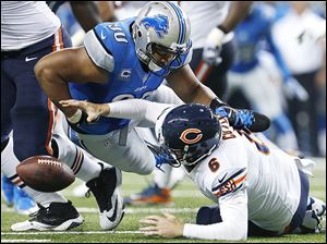 Detroit's Ndamukong Suh hits Chicago's Jay Cutler, causing a fumble Sunday that Nick Fairley recovered for a touchdown.