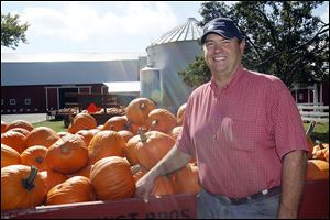 Dan Gust of Gust Brothers Pumpkin Farm in Ottawa Lake said big rains in June and July damaged some of his fields. Still, Mr. Gust and other farmers said, 'we've got a pretty good crop.'