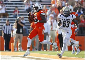 Bowling Green State University player Travis Greene (13) scores a touchdown against Akron University during the fourth quarter Saturday.
