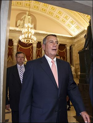 Speaker of the House John Boehner (R., Ohio) returns to his office after a vote over a measure that would prevent a possible shutdown of the federal government when it runs out of money.