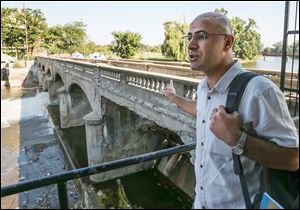 Assistant Professor Hisyar Ozsoy of the  University of Michigan Flint stands by the Hamilton Dam in downtown Flint. The dam is one of the worst-rated in the state and is in need of immediate repairs to maintain its structural integrity.
