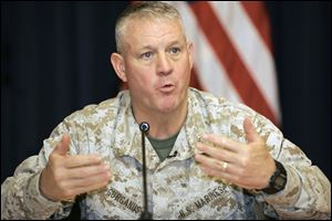 Brig. Gen. C. Mark Gurganus speaks to reporters at a news conference in Baghdad's heavily fortified Green Zone.