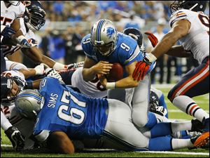Detroit Lions quarterback Matthew Stafford (9) falls over the goal line for a touchdown after recovering his own fumble.