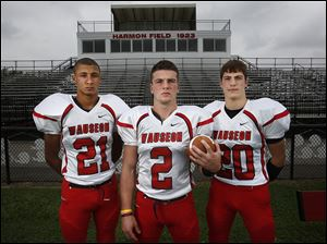 Wauseon is off to a 5-0 start with top players, from left, wide receiver Kris Boysel, quarterback Ty Suntken, and running back Axel Bueter.