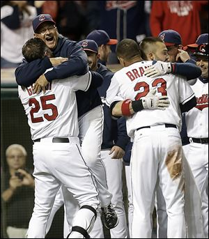 Cleveland Indians designated hitter Jason Giambi, left, picks up manager Terry Francona after Giambi hit a two-run home run off Chicago White Sox relief pitcher Addison Reed in the ninth inning Sept. 24.