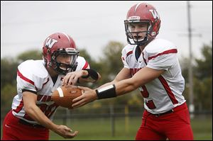 Wauseon senior Ty Suntken, who has run for 522 yards, hands off the ball to senior Axel Bueter, who has 770 yards rushing.