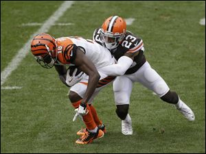 Cleveland Browns cornerback Joe Haden, right, tackles Cincinnati Bengals A.J. Green.