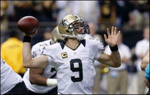 New Orleans Saints quarterback Drew Brees (9) passes in the first half.