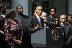 President Obama, accompanied by Health and Human Services Secretary Kathleen Sebelius, and people who support the Affordable Care Act, his signature health care law, speaks in the Rose Garden of the White House.