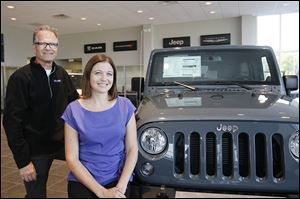 Owner Mike Rouen and his daughter, Nicole Hopkins, marketing manager, have expanded their Chrysler Dodge Jeep Ram showroom, following a trend to offer customers amenities such as a coffee lounge waiting area, big-screen television, and a kids' play area.