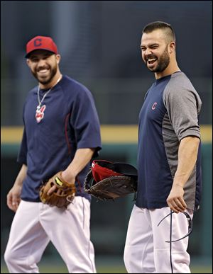 Cleveland Indians first baseman Nick Swisher, right, and second baseman Jason Kipnis keep things loose during a workout at Progressive Field. The Indians host Tampa Bay in a wild-card game.