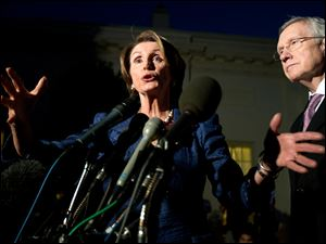 House Minority Leader Rep. Nancy Pelosi, D-Calif., left, with Senate Majority Leader Sen. Harry Reid, D-Nev., speaks to reporters following a meeting with President Barack Obama and the Republican leadership at the White House tonight.