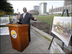 Toledo Mayor Mike Bell talks about the upcoming construction at Promenade Park during a news conference in the park Wednesday.