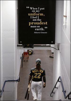 Pittsburgh Pirates' Andrew McCutchen (22) walks to the field before the National League wild-card playoff baseball game.