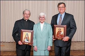Sister Mary Jon Wagner, Congregational Minister for the Sisters of St. Francis of Sylvania, center poses for a photo during the Sylvania Franciscan Gala with awardees Father Robert Wilhelm, recipient of the 2013 St. Clare Award, left, and Joseph Nachtrab, president of Northaven Development Group and recipient of the 2013 St. Francis Award.